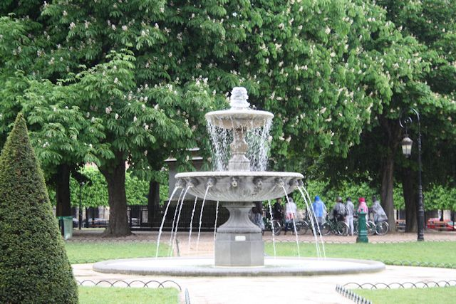 one of the fountains in the park at place des vosges